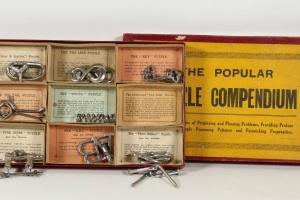 70/1876   [Games and toys. Patience puzzle games]. La croix du Sahara. L'E