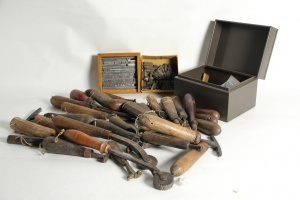 70/8   [Bookbinder's tools]. Lot of ±40 copper binding stamps,