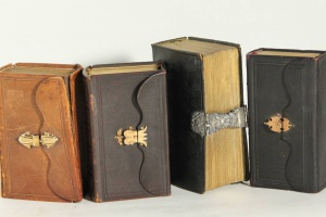 70/2860   [Bindings]. Lot of 4 19th cent. leather bindings with silver (1x